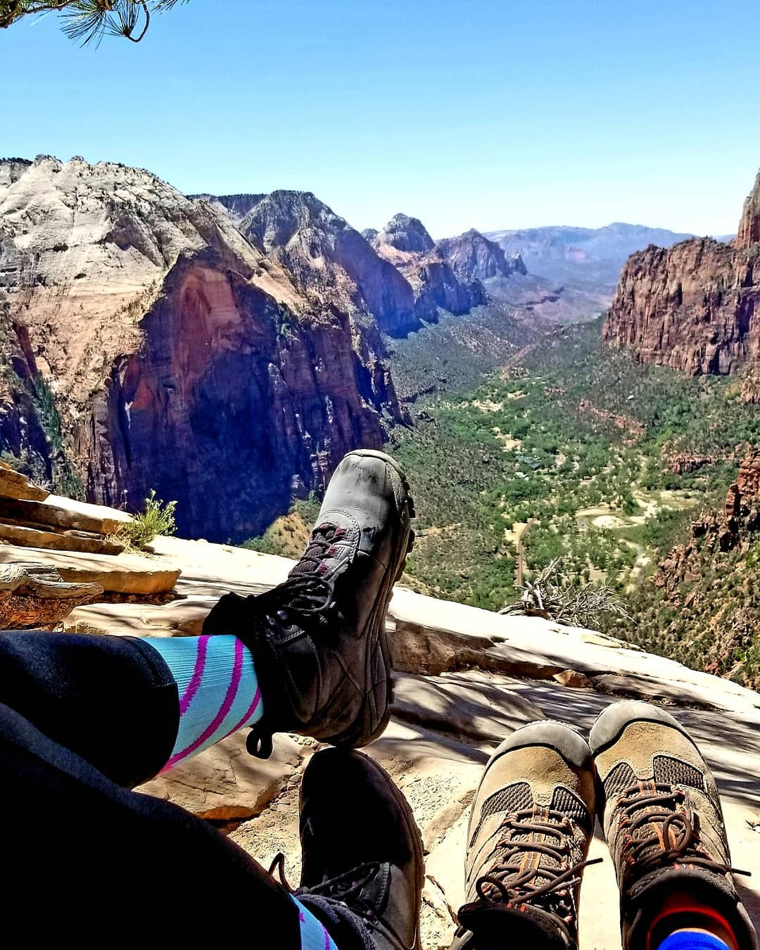 RN, May D., with her friend Erlinda at the top of Angels Landing in Utah (Photo Contest Winner for June!)