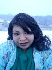 RN, Karyn E., enjoying a snowy day outside.