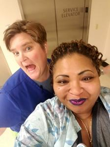 RN, Karyn E., posing for a selfie with her coworker.