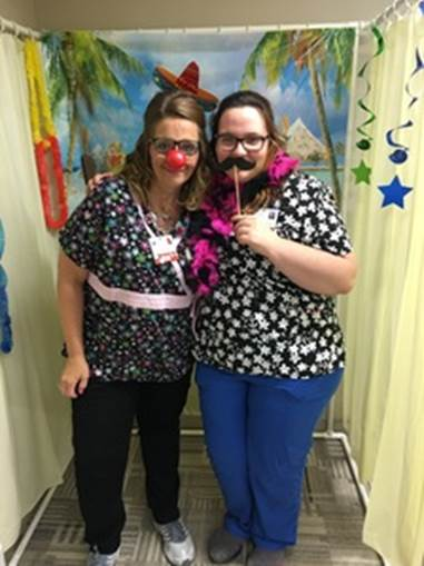 RN, Trisha P., posing  for a goofy photo with a friend during Nurses Week.